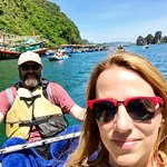 Me and my other half, exploring a floating fishing village during a fun, active itinerary trip