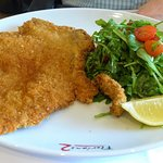 Veal Milanese served with rocket & Sicilian cherry tomatoes