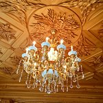 View of the chandelier and the wood work on the ceiling