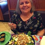 The wife about to dig into the huge cobb salad.