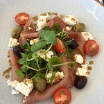 Prosciutto with feta cheese and olives