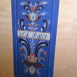 Rosemaling on the door of one of the rooms.