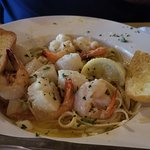 Shrimp and Scallops Scampi in a white wine garlic butter sauce over linguine -YUM!