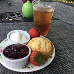 Scone with clotted cream and preserves. Ice tea!