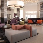 Spacious lobby with modern design provides and inviting space for guests to converse
