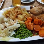Half roast chicken with homemade chips and veg and gravy all for €7 absolutely gorgeous.