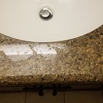 Bathroom counter not wiped down.