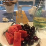 Complimentary fruit and raki