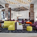 Our modern lobby is appointed with technology infused décor with outlets in unconventional place