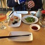Sushi, seaweed salad and drinks