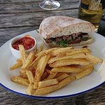 The steak sandwich with fries (half eaten before remembering to take a picture of it)