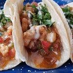 Various seafood tacos