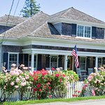 The restored old homes of Chatham exemplify the classic Cape Cod style. Check out this rose gard