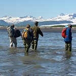 Wading from the float plane to the shore of Katmai National Park