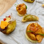 The indecent bed- Fisherman empanada, stuffed blue potato with lamb, sea urchin toast