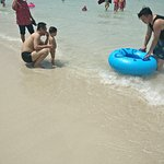 A cute kid being taught on how to use the float. P.S - They failed. He just wanted to jump in !!