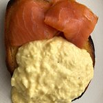 scrambled eggs with smoked salmon on brioche