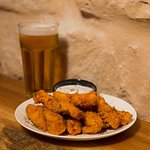 Perfectly cooked crispy Buffalo Tenders and Cold Draft Beer