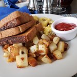 Eggs with diced spicy sausage, home fries and wheat toast