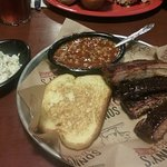 6 St. Louis ribs with baked beans, coleslaw and garlic bread.