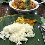 Hot steaming rice served on banana leaf