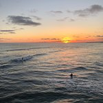 sunset and surfers from the pier, fun to watch the surfers
