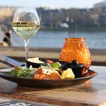 Join us in the sun with a great dinner and a glass of wine and enjoy the wonderful view at Café
