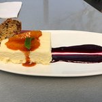 White chocolate cheesecake with biscotti, blood orange compote