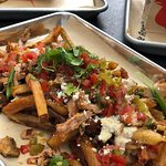 Schmaltz fries with added toppings - a delicious snack to be shared by all
