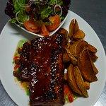 Our Pork Ribs platter, with pepper jelly glaze, seasoned wedges & garden salad.