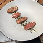 Duck breast with soy sauce and sesame seeds