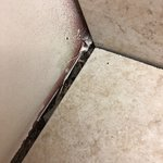 Bathroom floor dislodging from floor and dirty