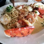 Lobster House Specailty - Maine Lobster tail with shrimp and scallops over liguine