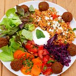 Falafel plate with salads, couscous and joghurt-mint-dip