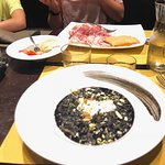 Squid ink risotto with charcuterie in the background~