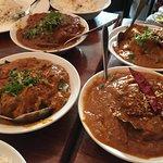 clockwise from top left: Lamb Rogan Josh, chicken madras, lamb madras and chettinad chicken