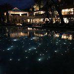 Pool and hotel at night.