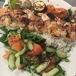 Seafood Kabob with white rice and a salad