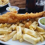 Medium !!! Haddock, chips, mushy pea, slice of bread and butter and Tartare sauce. Heaven on a p