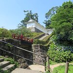 From the garden, walk up the stairs then the bridge, and further up