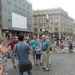 Guide in Rome talking about the history of the square as we walk to the Capuchin. monastery.