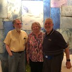 The three of us in front of a mural in the dining room