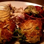 Eastern Shore Crab Cakes with tomato/onion/cucumber salad, red skin potato salad; chili remoulad