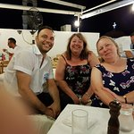 2 happy customers with Yanni and Nikos in the background