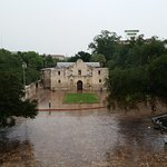 View of teh Alamo from teh 1718 Steakhouse on a rainy day.