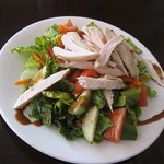 My wife enjoyed her salad topped with chicken.