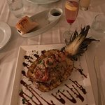 Grilled pineapple stuffed with rice, chicken and shrimp. Delicious!