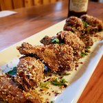 Larb Chicken Wings with fresh Thai herbs and roasted ground rice