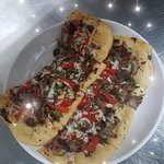 Sicilian Beef Flat Bread! Dough made in house! Fresh and made to order! LUNCH menu
