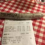 Bill for house wine, 2 traditional dishes and water